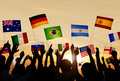 Silhouettes Of People Holding Flags From Various Countries Royalty Free Stock Photography - 41520437