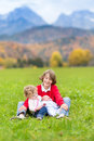 Three Kids In Beautiful Snow Covered Mountains Stock Photos - 41533123