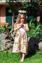 Cute Little Girl With Flowers Chaplet Stock Image - 41546941