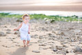 Funny Toddler Girl Running At The Beach At Sunset Stock Photo - 41551720