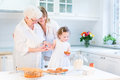 Woman Baking Cake With Senior Mother, Grand Daughter Royalty Free Stock Image - 41566966