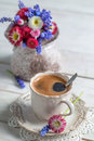 Cup Of Hot Coffee And Spring Flowers Royalty Free Stock Image - 41569516