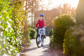 Happy Smiling Teenager Boy Riding His Bike On Sunset Stock Images - 41587884