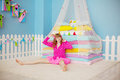 Woman Like A Doll In A Nursery Stock Photo - 41589530