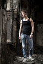 Portrait Yog Young Man In Shirt And Jeans Standing On Abandoned Background. Royalty Free Stock Photo - 41601325