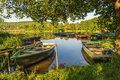 Under The Trees, Boats In The Harbor At Lake Stock Image - 41642311