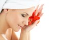 Happy Woman With Red Flower Petals Stock Image - 41647281