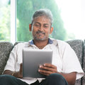 Indian Man Using Digital Tablet Computer Royalty Free Stock Photography - 41652927