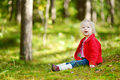 Adorable Toddler Girl Sitting In The Forest Royalty Free Stock Image - 41660676