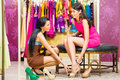 Asian Sales Lady In Shop Offering Shoes Stock Image - 41663351
