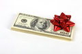 Stack Of Money American Hundred Dollar Bills With Red Bow Royalty Free Stock Image - 41666486