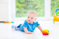 Beautiful Baby Boy With Colorful Ball And Toy Car Royalty Free Stock Photography - 41694057