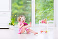 Funny Toddler Girl Playing Tambourine In White Room Stock Photo - 41694100
