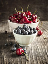 Fresh Blueberry And Sweet Cherry In Bowls Royalty Free Stock Photo - 41697005