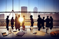 Silhouettes Of Business People Brainstorming Inside The Office Stock Photography - 41699442
