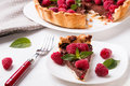 A Piece Of Chocolate Tart With Raspberry Royalty Free Stock Photo - 41726325