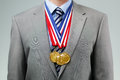 Succesful Businessman With Gold Medals Stock Photo - 41761150