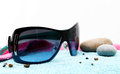 Sunglasses And Stones On A Beach Towel Stock Photography - 41770952