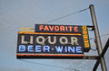 Liquor Sign With Blue Sky In The Background Royalty Free Stock Image - 41780826