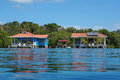 Off Grid Over Water Bungalows With Solar Panels Royalty Free Stock Photos - 41801878