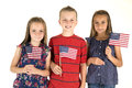 Three Cute Children Holding American Flags Happy Royalty Free Stock Image - 41802916