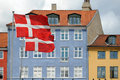 Flags And Colored Houses In Copenhagen, Denmark Stock Photo - 41845780