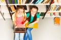 Two Smiling Girls Portrait From Above In Library Stock Photos - 41852153