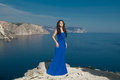 Fashion Happy Beautiful Woman In Long Dress Over Blue Sky, Outdo Stock Photo - 41875090