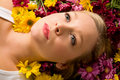 Young Woman Laying In Flowers Royalty Free Stock Photography - 4192137