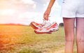Young Girl In Shorts Holding Her Sneakers Royalty Free Stock Photos - 41920318