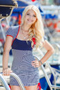 Beautiful Sexy Blonde In A Striped Dress Near Boats Royalty Free Stock Photos - 41931748