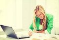 Smiling Student Girl Writing In Notebook Stock Image - 41936401
