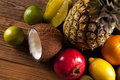 Super Tasty Tropical Fruits On Wooden Table Stock Photos - 41937013