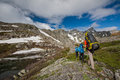 Hikers Are Climbing Rocky Slope Of Mountain Stock Photography - 41973562