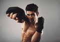 Strong Young Man Practicing Shadow Boxing Royalty Free Stock Image - 41999116