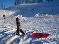 Boy With Red Sled In Snow Stock Photos - 427343