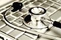 Technology And Medicine - Silver Stethoscope Over Royalty Free Stock Photography - 4200887