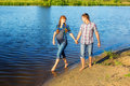 Happy And Young Pregnant Couple Having Fun On The Beach. Summer Stock Images - 42040084
