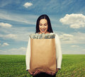 Smiley Woman Holding Paper Bag With Money Royalty Free Stock Photos - 42081318