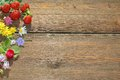 Summer Flowers And Berries On Grunge Wood  Board Royalty Free Stock Images - 42102279