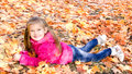 Autumn Portrait Of Cute Smiling Little Girl Lying In Maple Leave Royalty Free Stock Photos - 42133508
