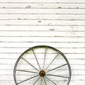 Antique Wooden Wagon Wheel On Rustic White Background Stock Images - 42146584