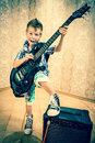 Cool Little Boy Posing With Electric Guitar. Royalty Free Stock Photo - 42179415