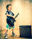 Cool Little Boy Posing With Electric Guitar. Royalty Free Stock Photography - 42179427