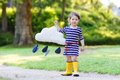Cute Toddler Girl In Yellow Rubber Boots Royalty Free Stock Image - 42185636
