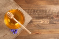 Honey In A Glass Bowl On A Wooden Boards Background Stock Images - 42197464