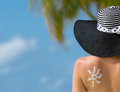 Woman With Sun-shaped Sun Cream Royalty Free Stock Photo - 42198435