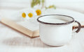 Milk In Metal Mug And Chamomile Flowers In Open Book Stock Image - 42221521