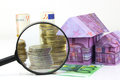 Euro Bill House And Expenses Under Magnifying Glass Royalty Free Stock Image - 42233016