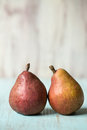 Two Pears On Blue Wood Table Stock Images - 42240234